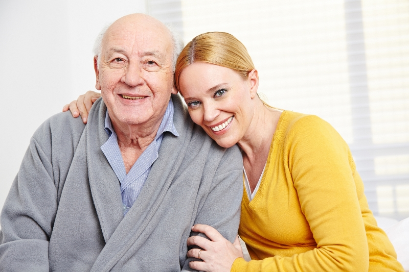 Image of a elderly man with a caregiver