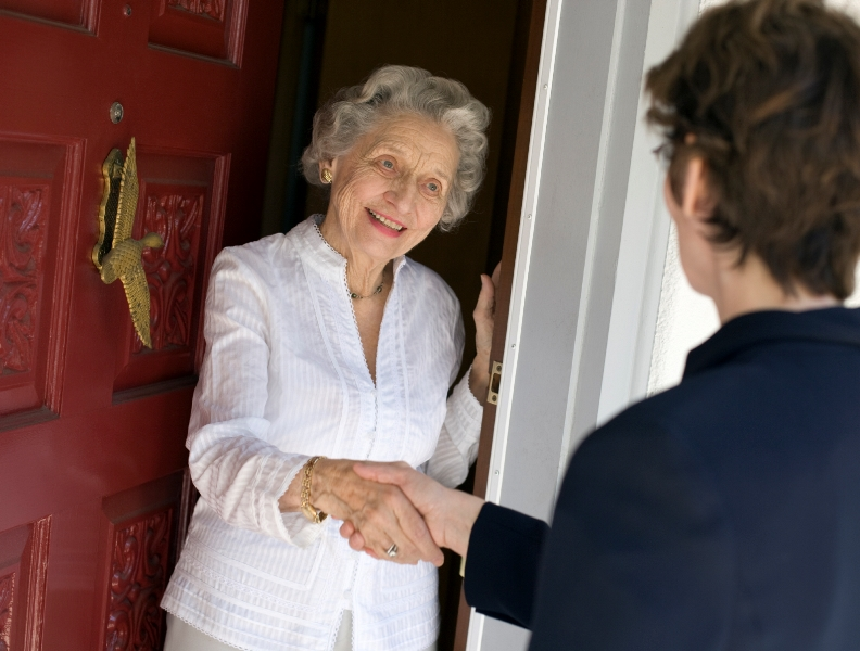 Image of a lady answering the door
